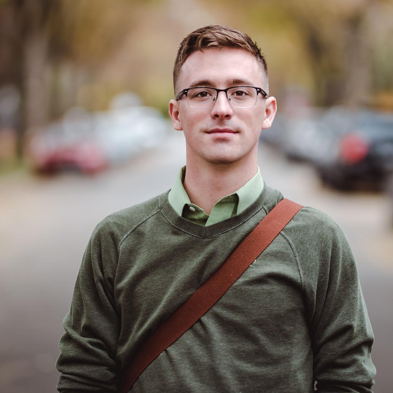 young man with messenger bag